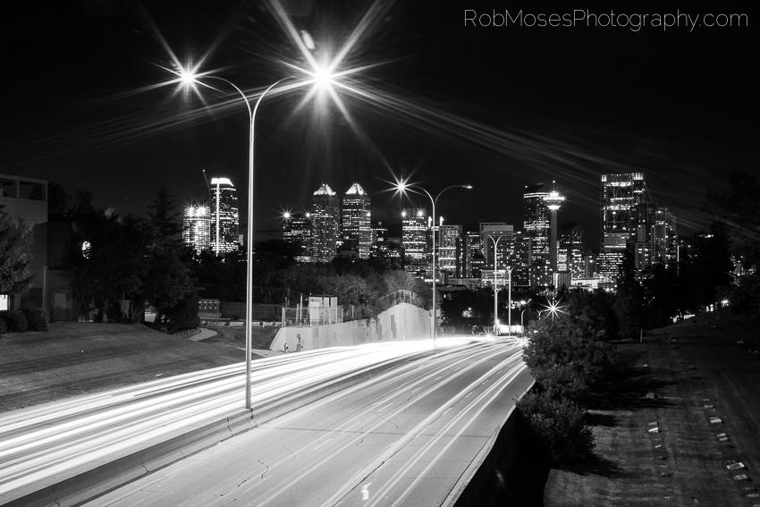 Calgary City Skyline Night Black & White car lights street freeway - Rob Moses Photography